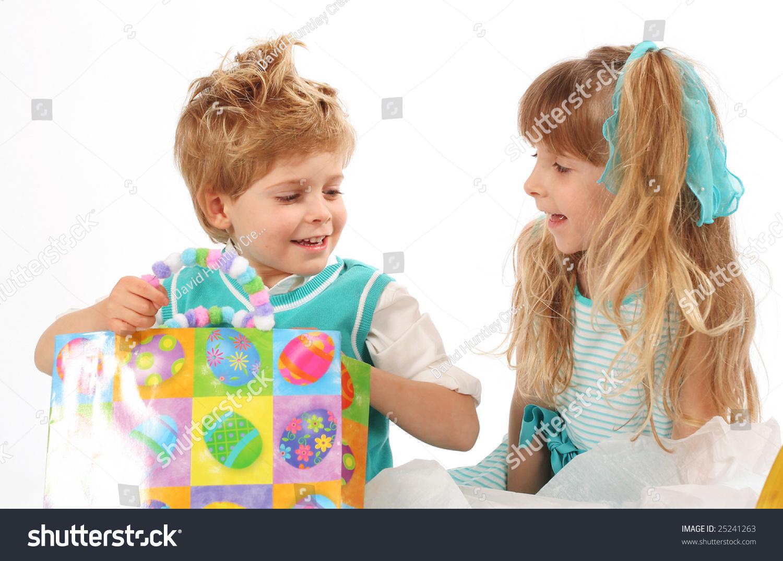 Precious little boy girl giving easter stock photo 25241263 precious little boy and girl giving easter gifts negle Choice Image