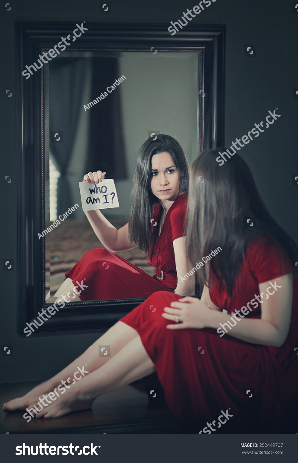 Woman looking into mirror asking who stock photo 252449707 for Looking mirror