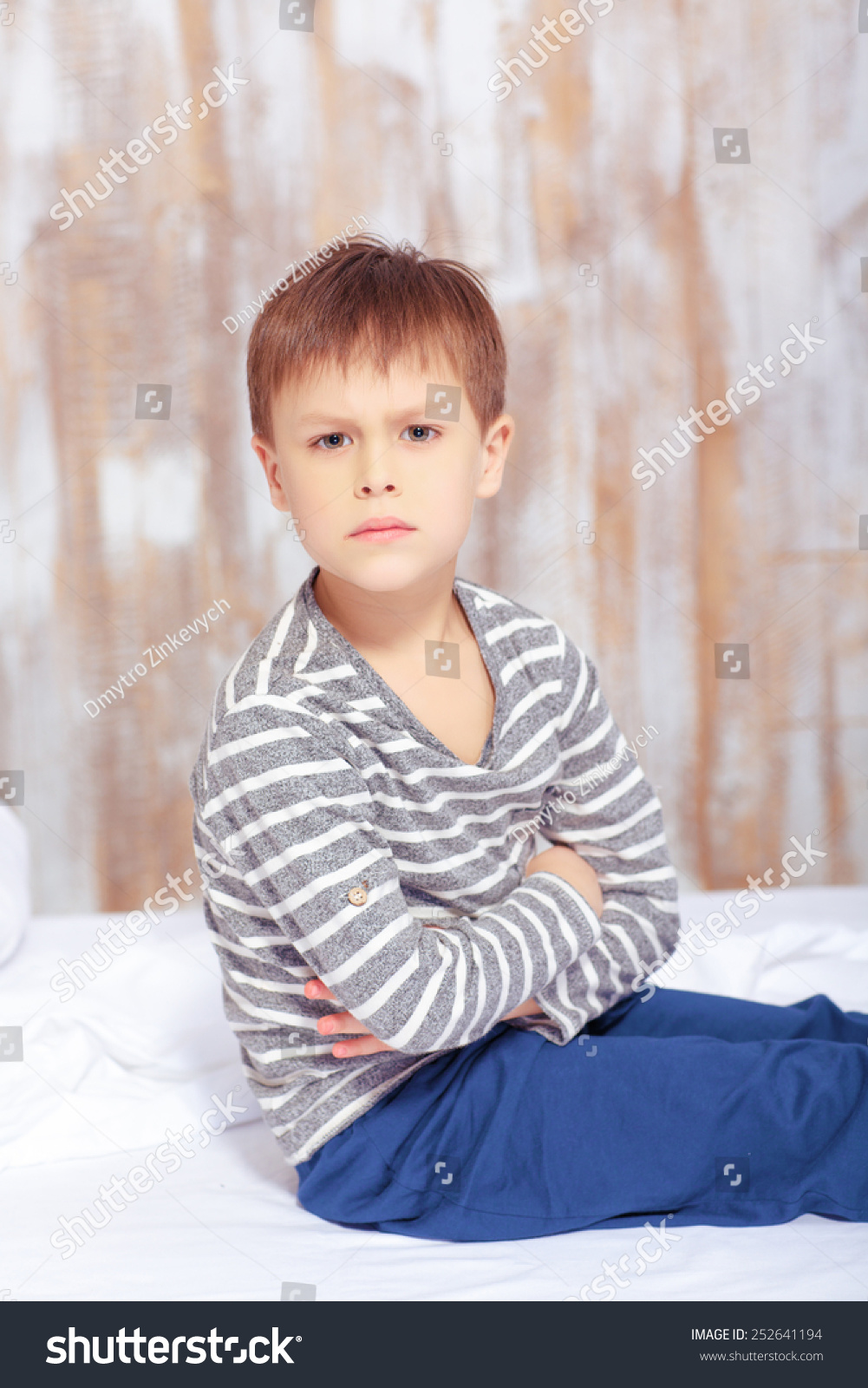 Naughty Little Boy. Sad Little Boy Keeping Arms Crossed While Sitting In Bed In Pajama ...
