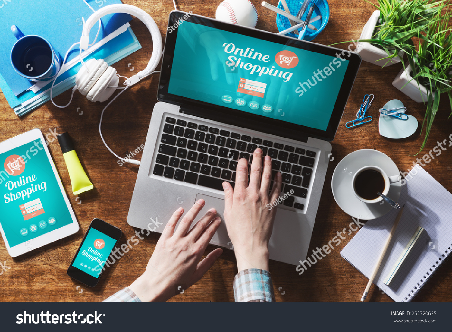 Online shopping website on laptop screen with female hands typing #252720625