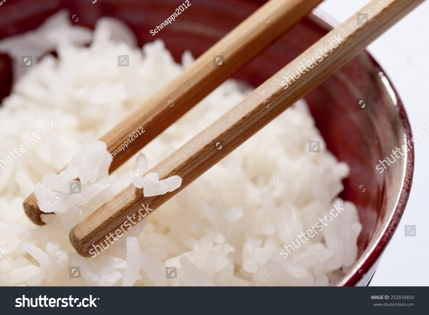 Bowl Of Rice With Chopsticks On White Background Stock ...