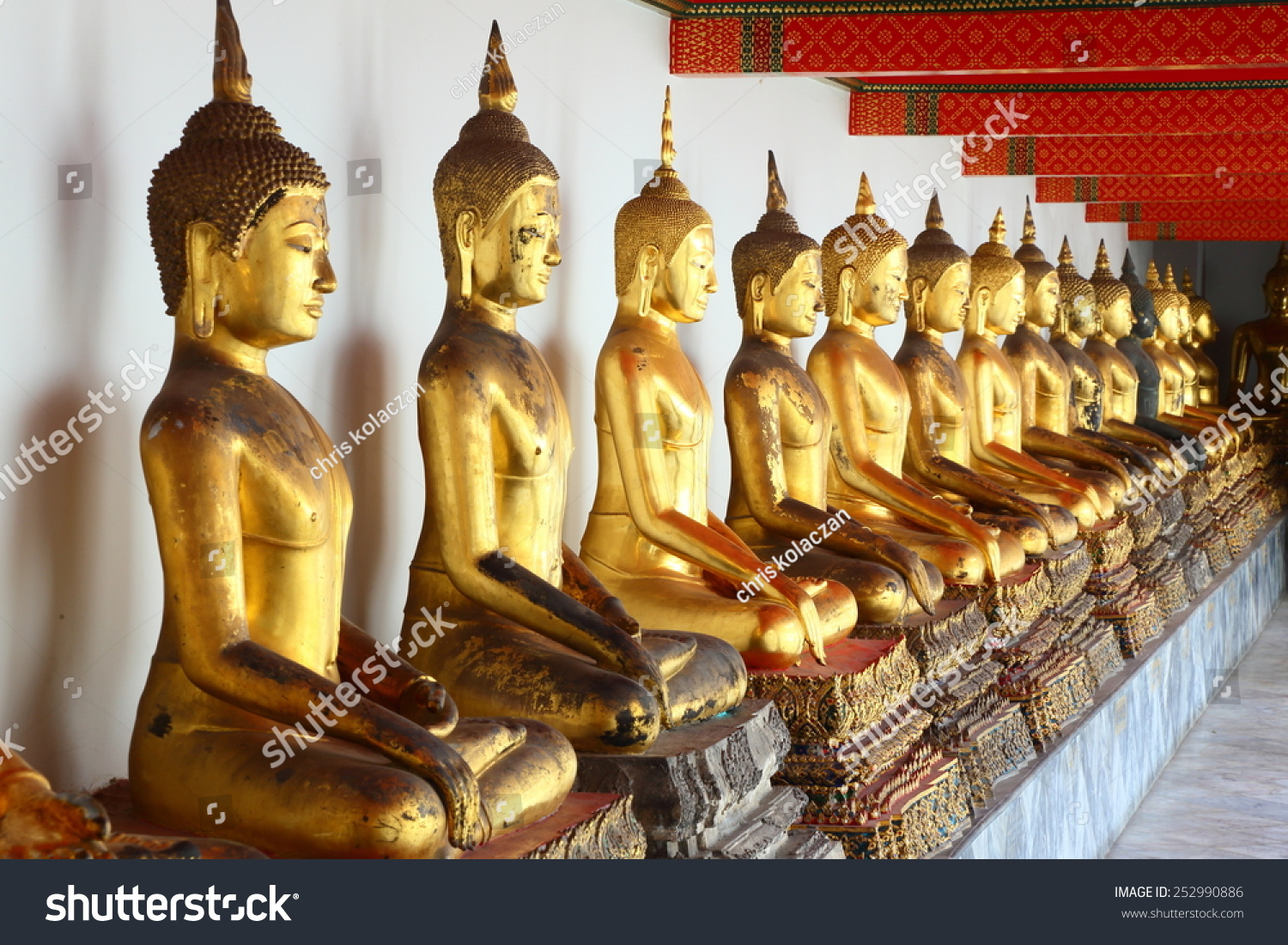 Series ancient golden buddha statues lined stock photo 252990886 a series of ancient golden buddha statues lined up in a row a beautiful collection biocorpaavc Choice Image