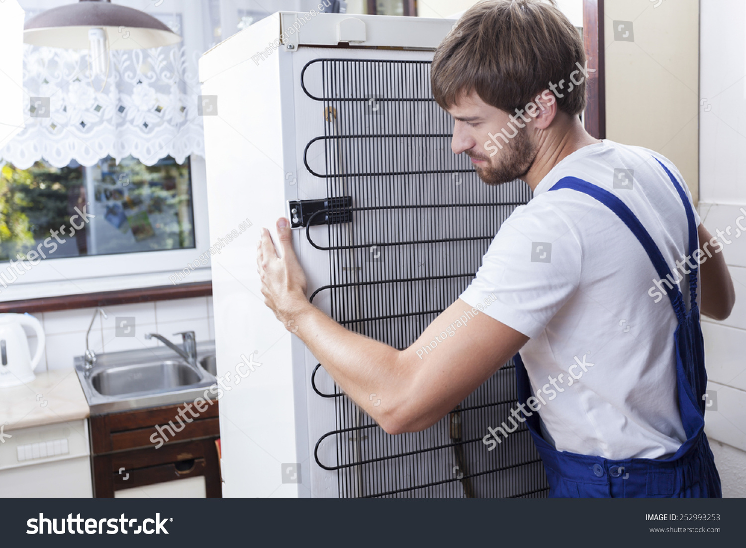 how to move a fridge safely