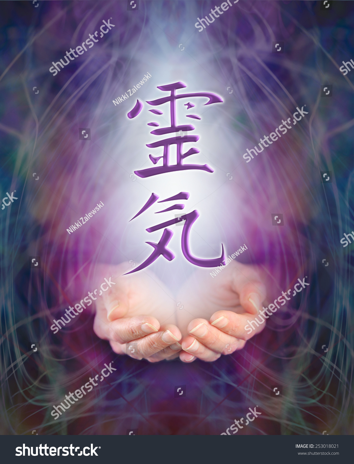 Sending reiki healing female cupped hands stock photo 253018021 sending reiki healing female cupped hands with the japanese reiki kanji symbol floating above on buycottarizona Gallery