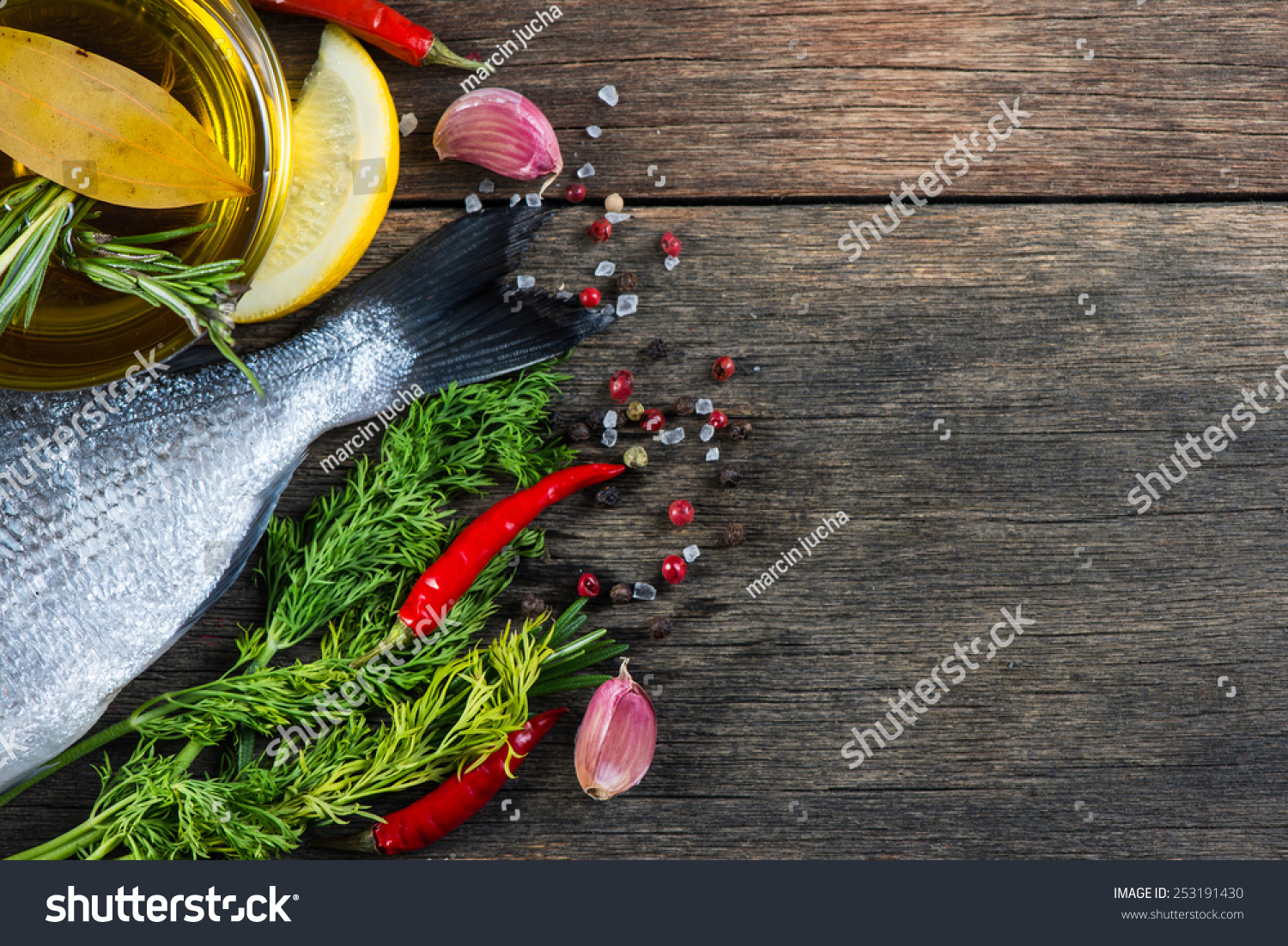 fresh whole sea fish with aromatic herbs and spices stock On aromatic herb for fish