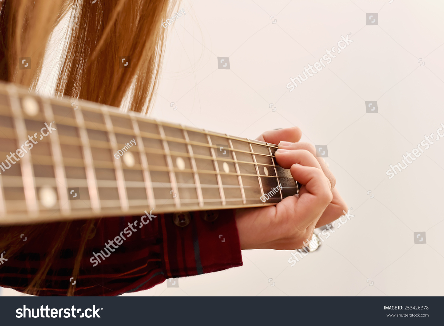 Royalty Free Womans Hands Playing Acoustic Guitar 253426378