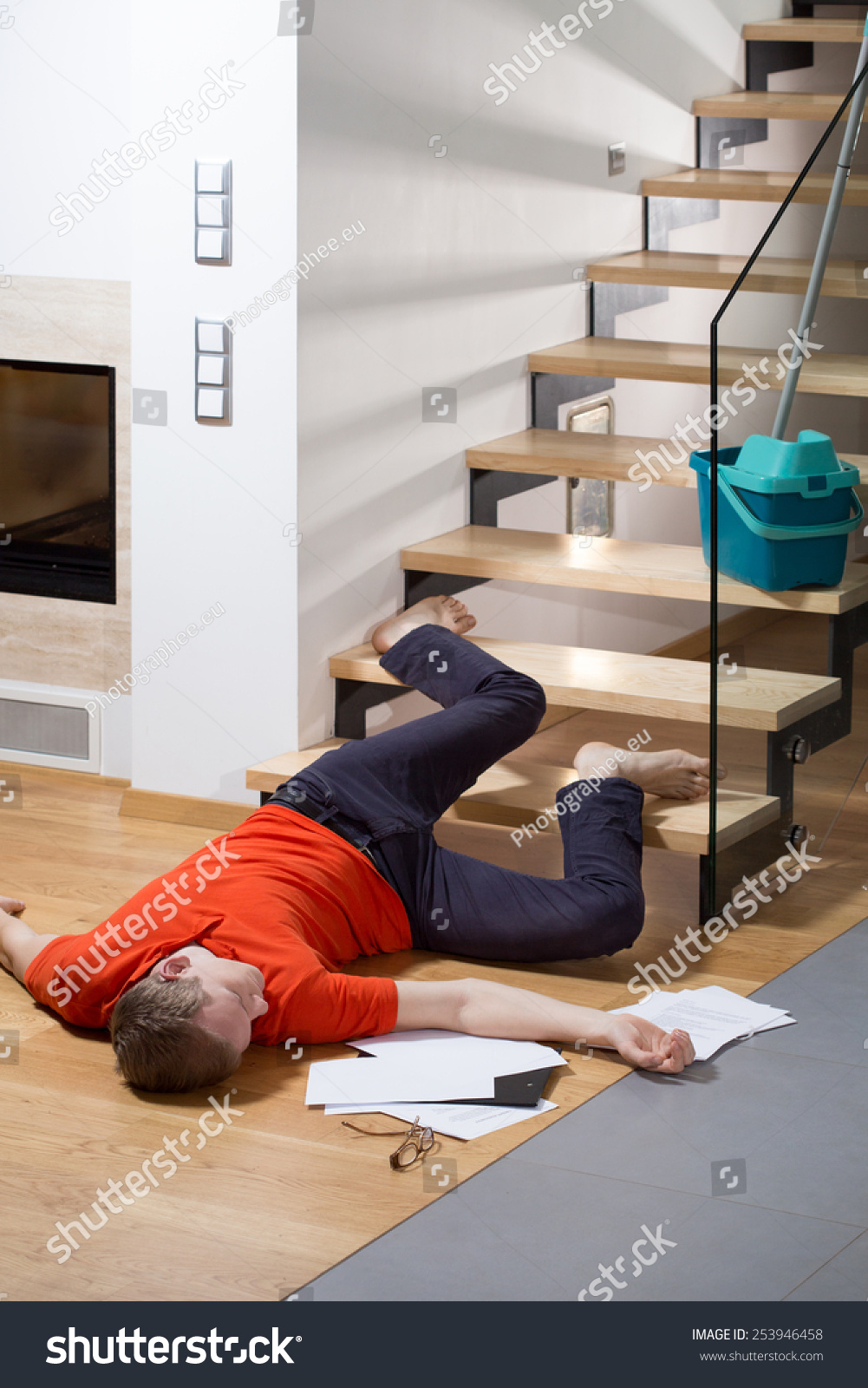 Injured man lying on floor after stock photo 253946458 for Down to the floor