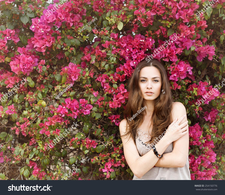 Portrait Of A Beautiful Brunette Girl In Summer Colors Flowers Ez