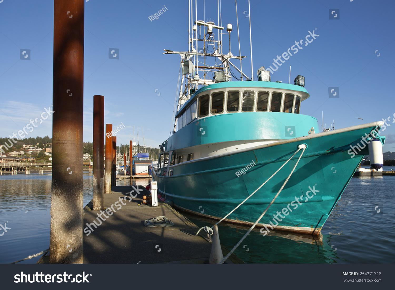 Fishing boat moored newport oregon stock photo 254371318 for Newport oregon fishing