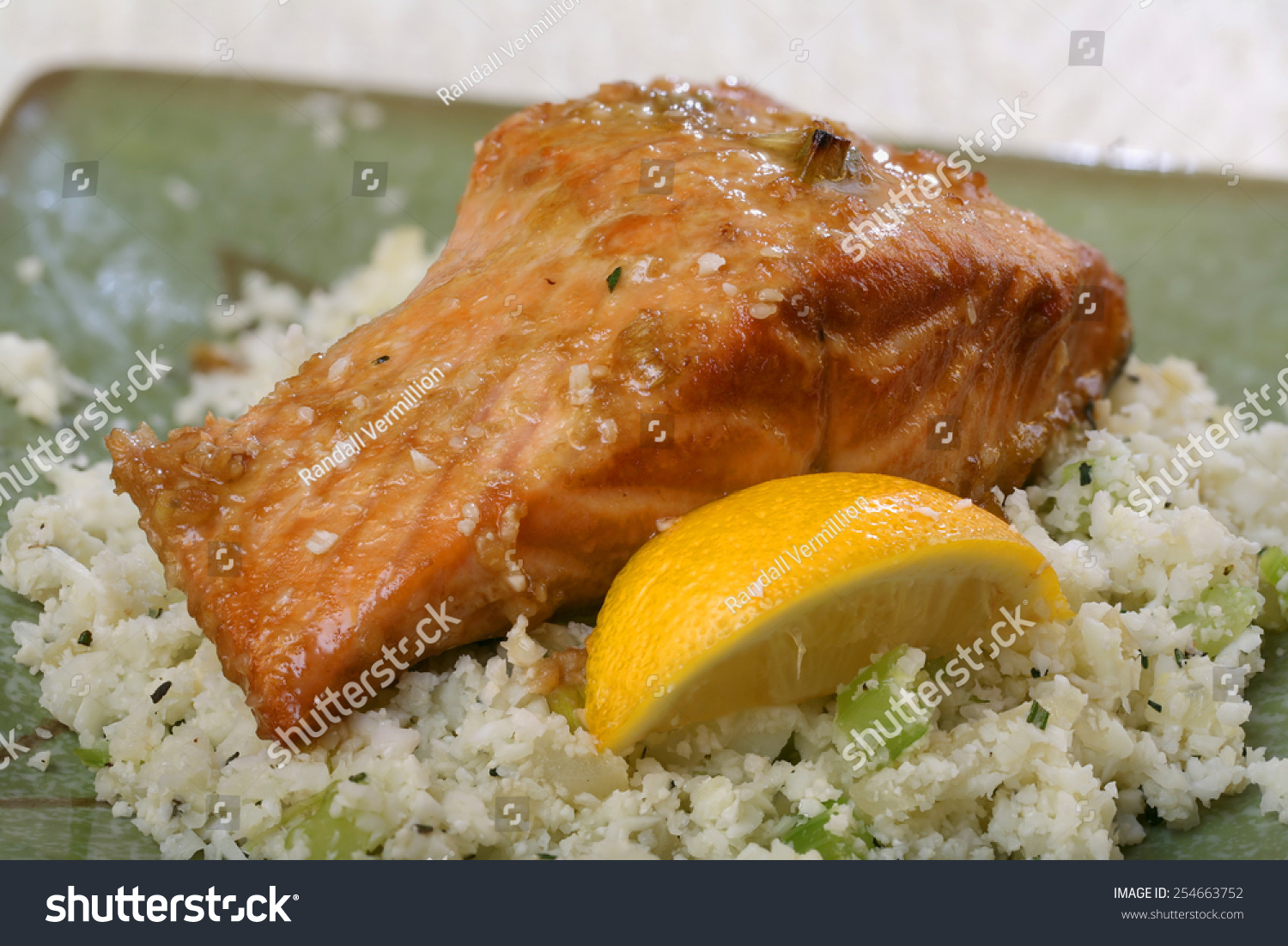 baked salmon with lemon wedge and rice cauliflower side dish stock photo 254663752 shutterstock. Black Bedroom Furniture Sets. Home Design Ideas