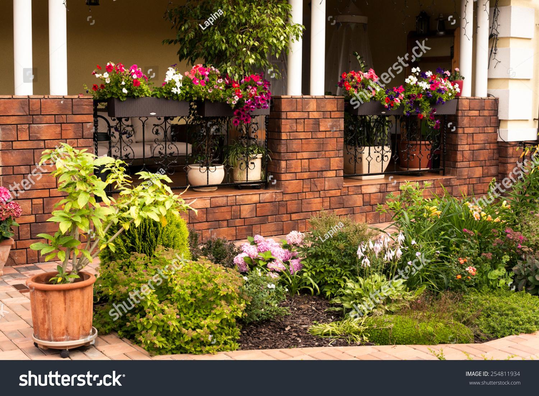 Beautiful garden flower box pot plants stock photo edit now beautiful garden with flower box and pot plants on the porch izmirmasajfo