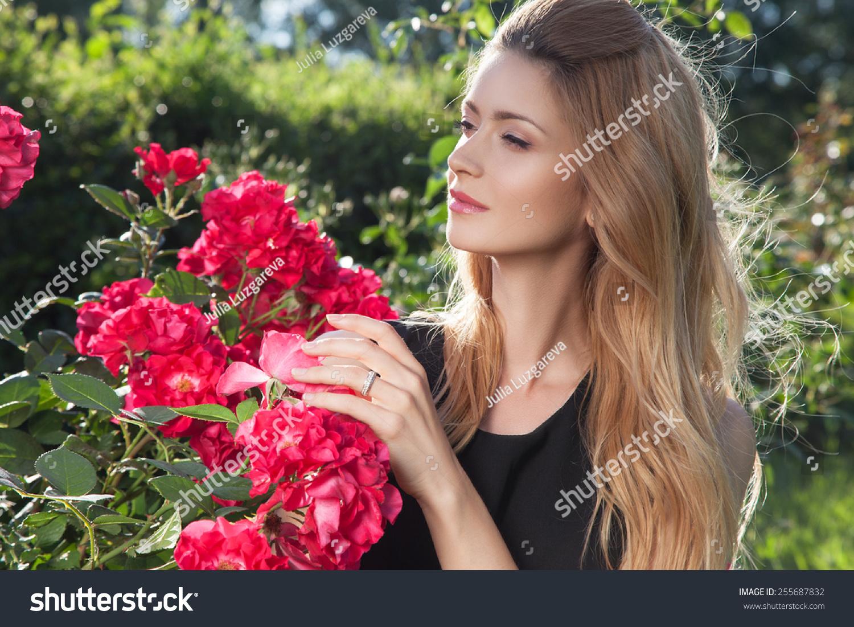 Beautiful young woman on walk girl stock photo edit now 255687832 beautiful young woman on a walk girl in flowers girl with flowers beautiful izmirmasajfo
