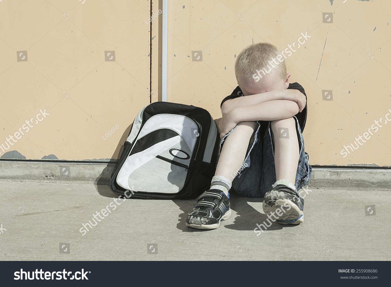 boy bullying school playground very sad stock photo edit now