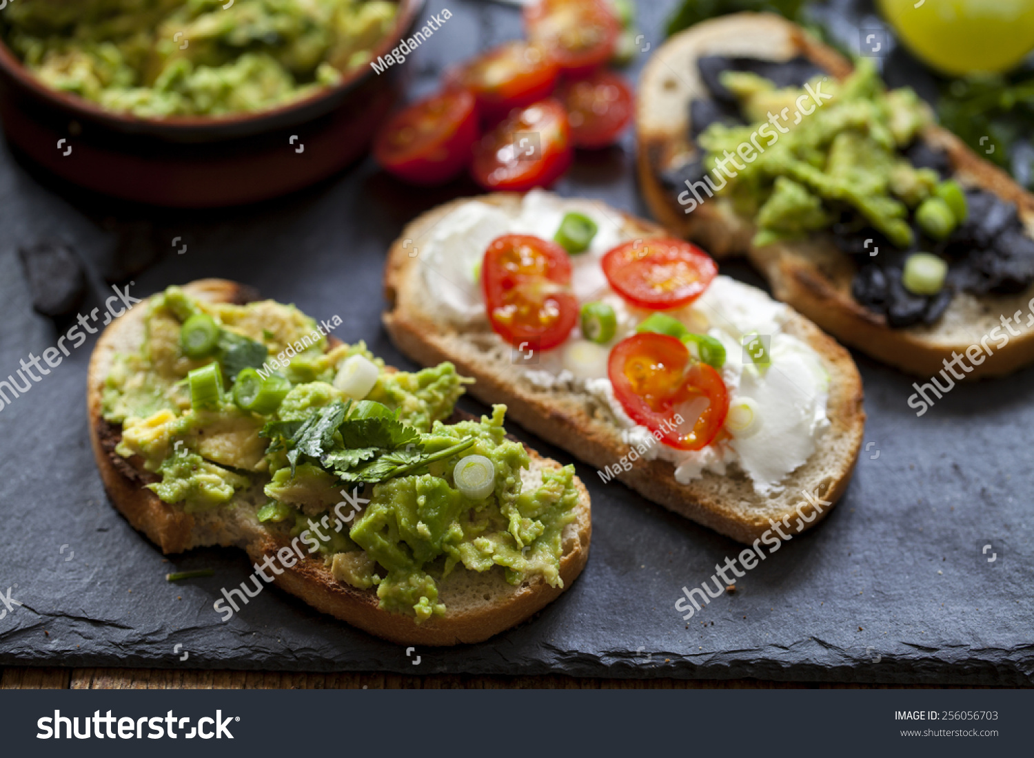 Canapes avocado spread goat cheese black stock photo for Canape spread