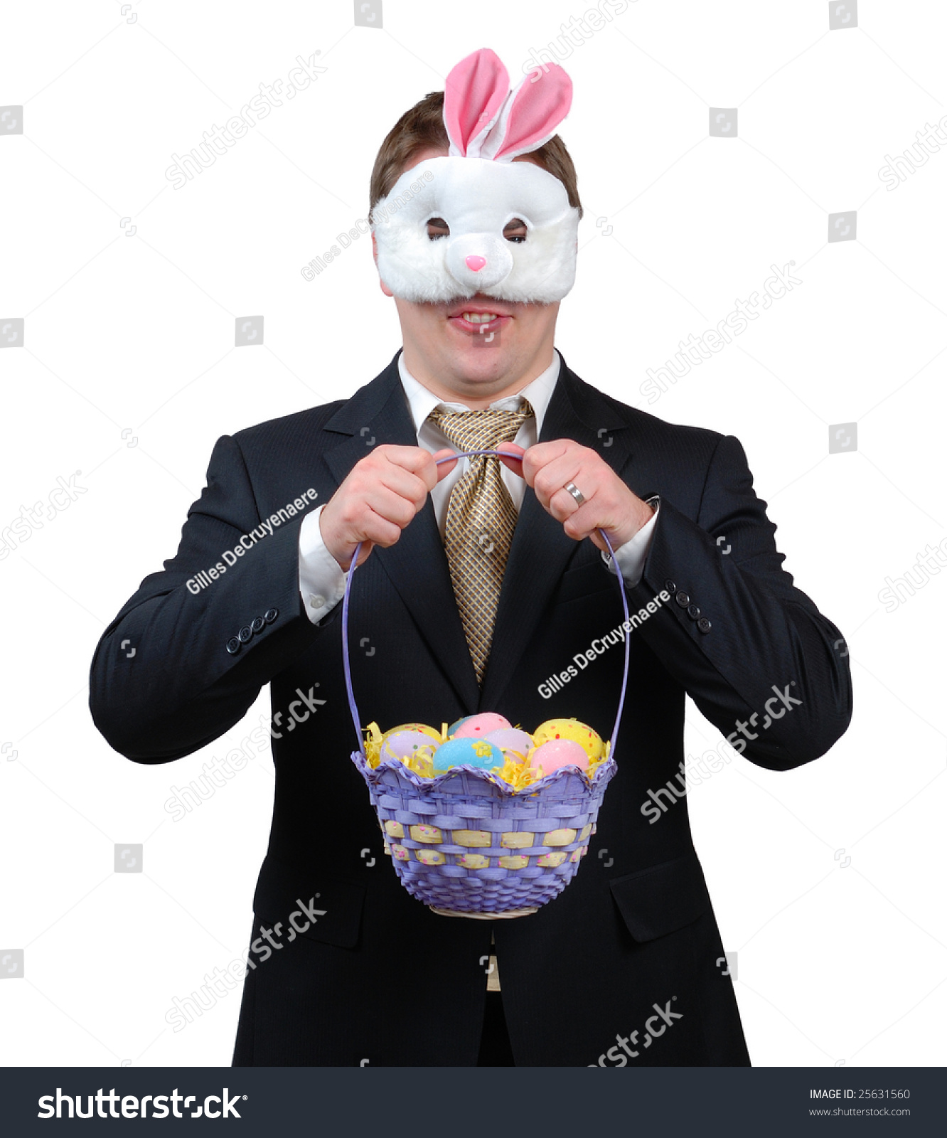 Young man wearing suit easter bunny stock photo 25631560 young man wearing suit with easter bunny mask holding an easter basket full of brightly negle Gallery