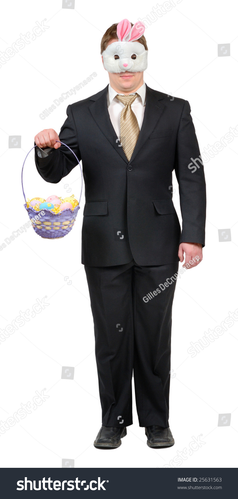 Young man wearing suit easter bunny stock photo 25631563 young man wearing suit with easter bunny mask holding an easter basket full of brightly negle Gallery