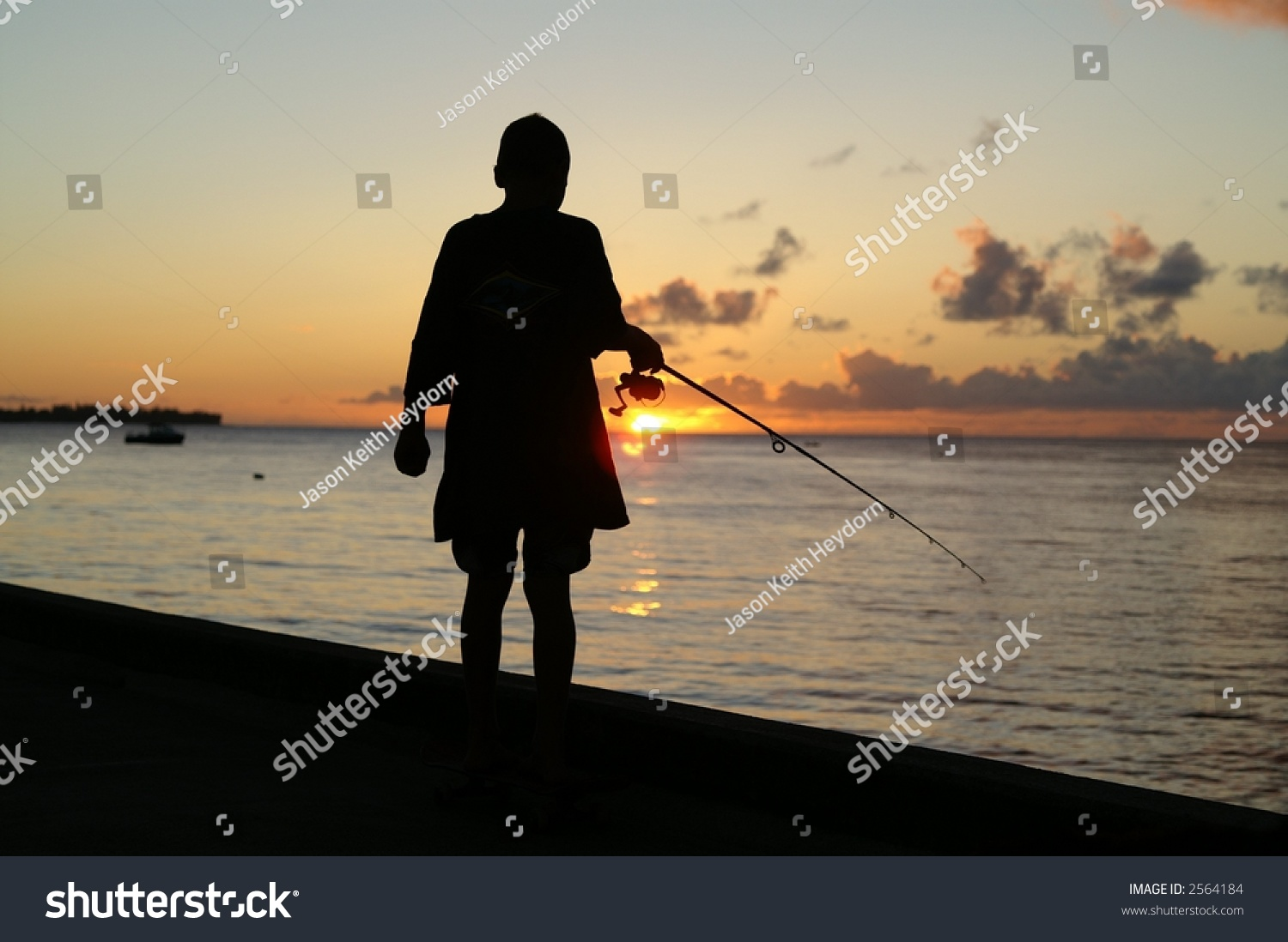 Boy fishing off pier stock photo 2564184 shutterstock for Fishing off a pier