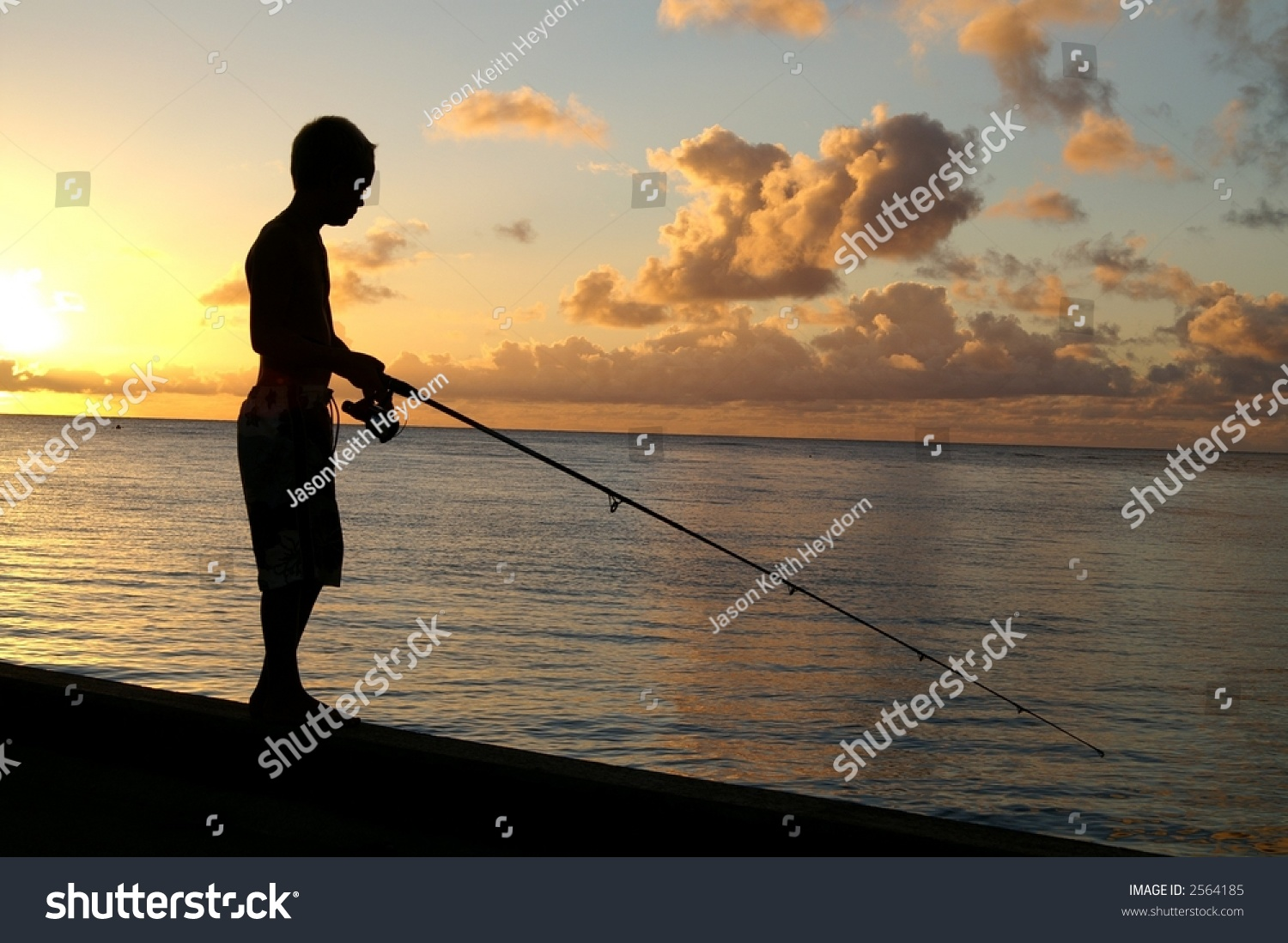Boy fishing off pier stock photo 2564185 shutterstock for Fishing off a pier