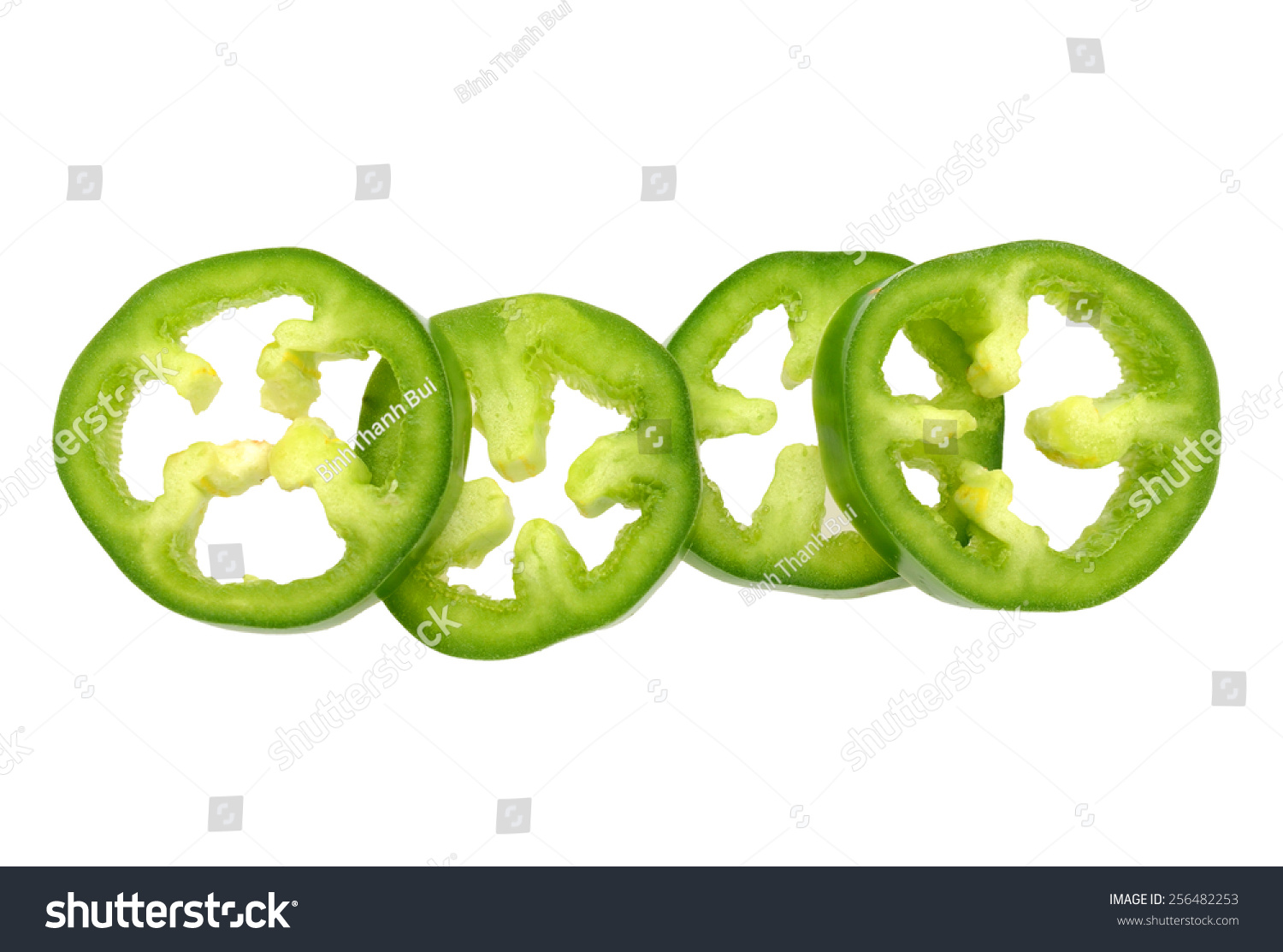 finely chopped jalapeno peppers on row stock photo