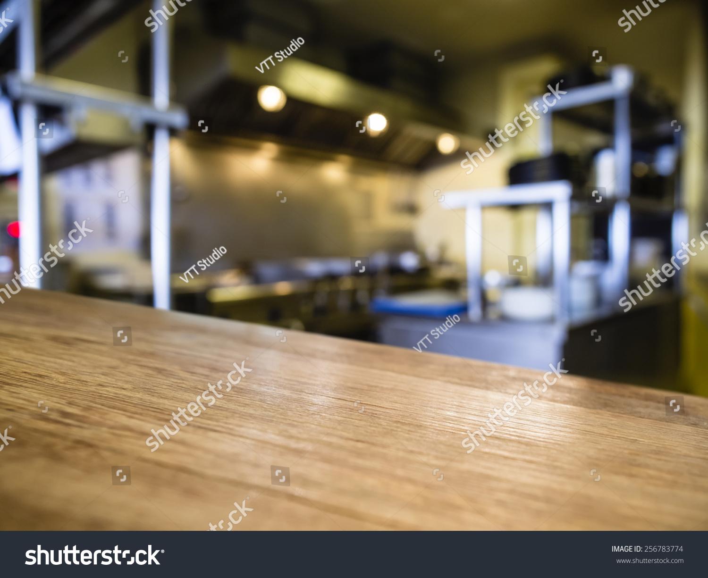 Top wooden counter blurred kitchen restaurant stock photo