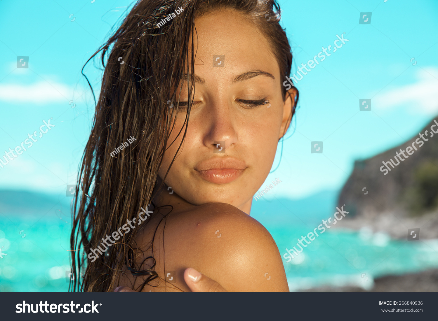 carefree beautiful brunette wet look long stock photo (royalty free