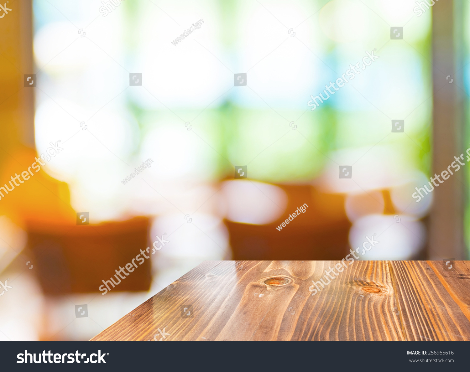Empty wood table and blurred living room background stock photo - Empty Wood Table At Blurred Garden Cafe Background