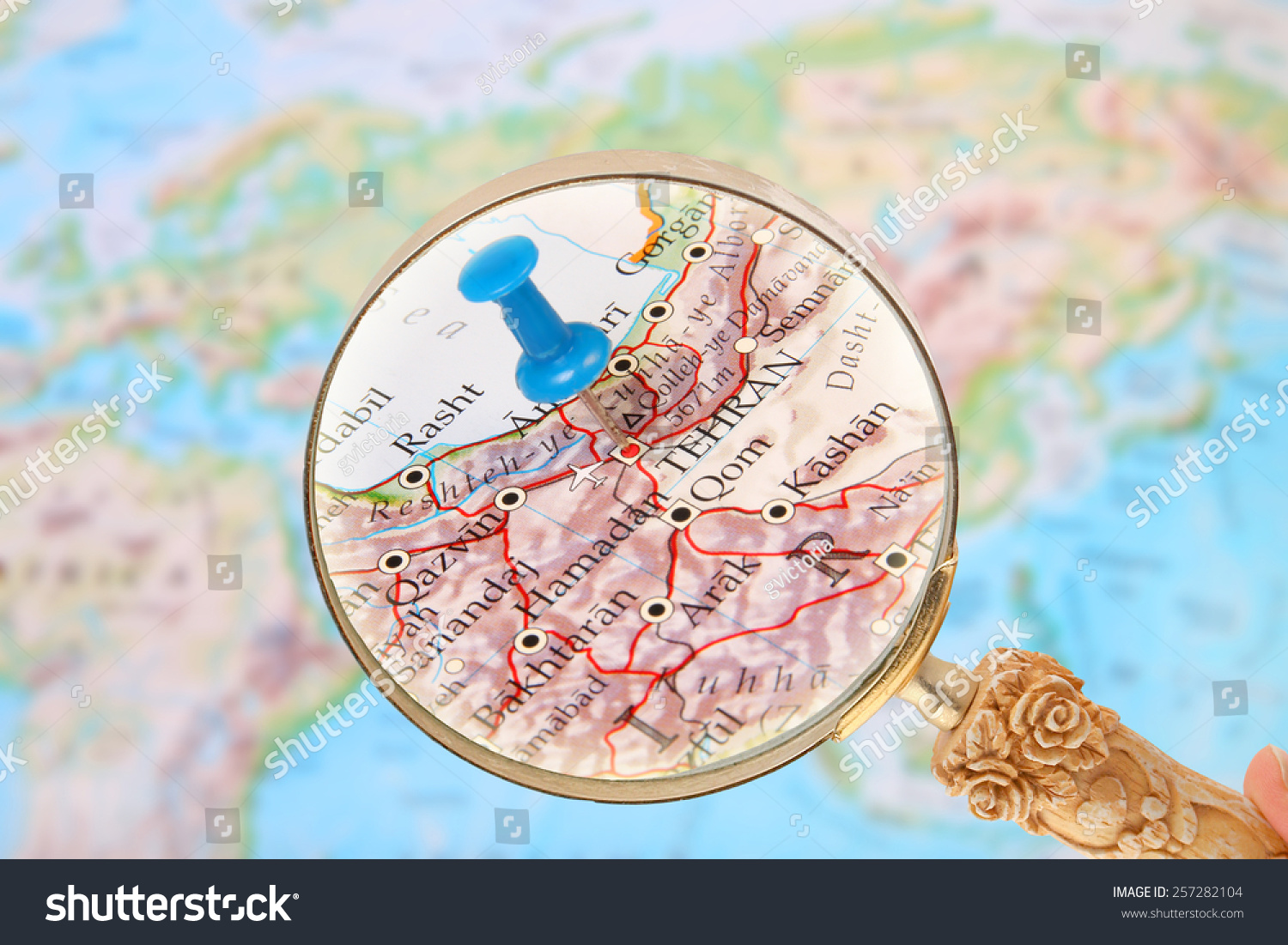 Blue tack on map world magnifying stock photo royalty free blue tack on map of the world with magnifying glass looking in on tehran iran gumiabroncs Image collections