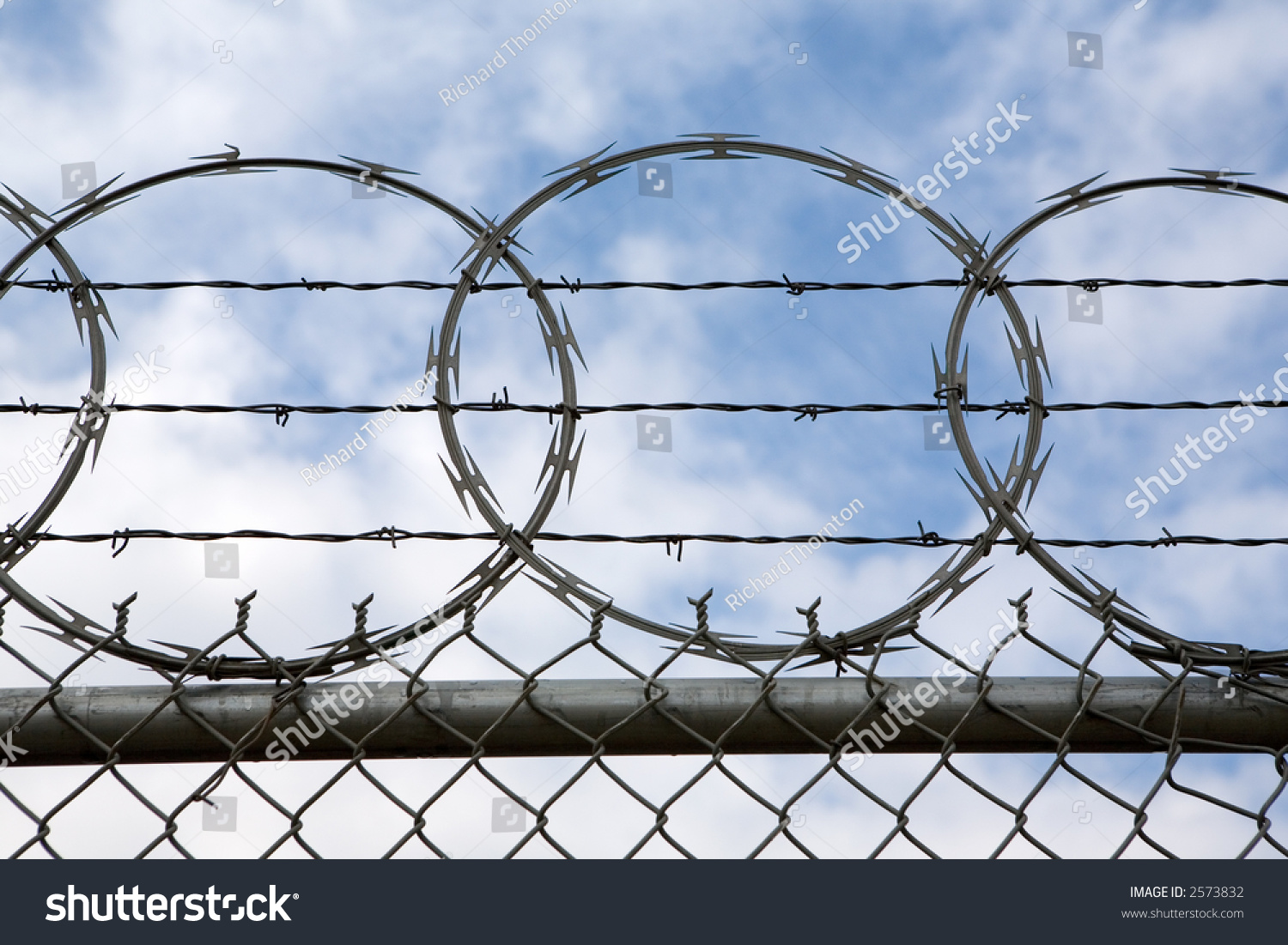 Concertina Wire Atop Fence Presents Tough Stock Photo (Royalty Free ...