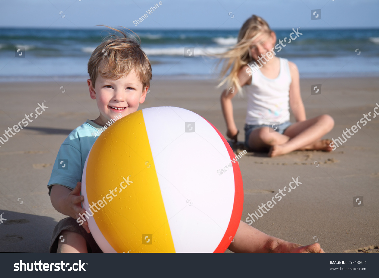 Young Boy Holds Beach Ball On Stock Photo 25743802