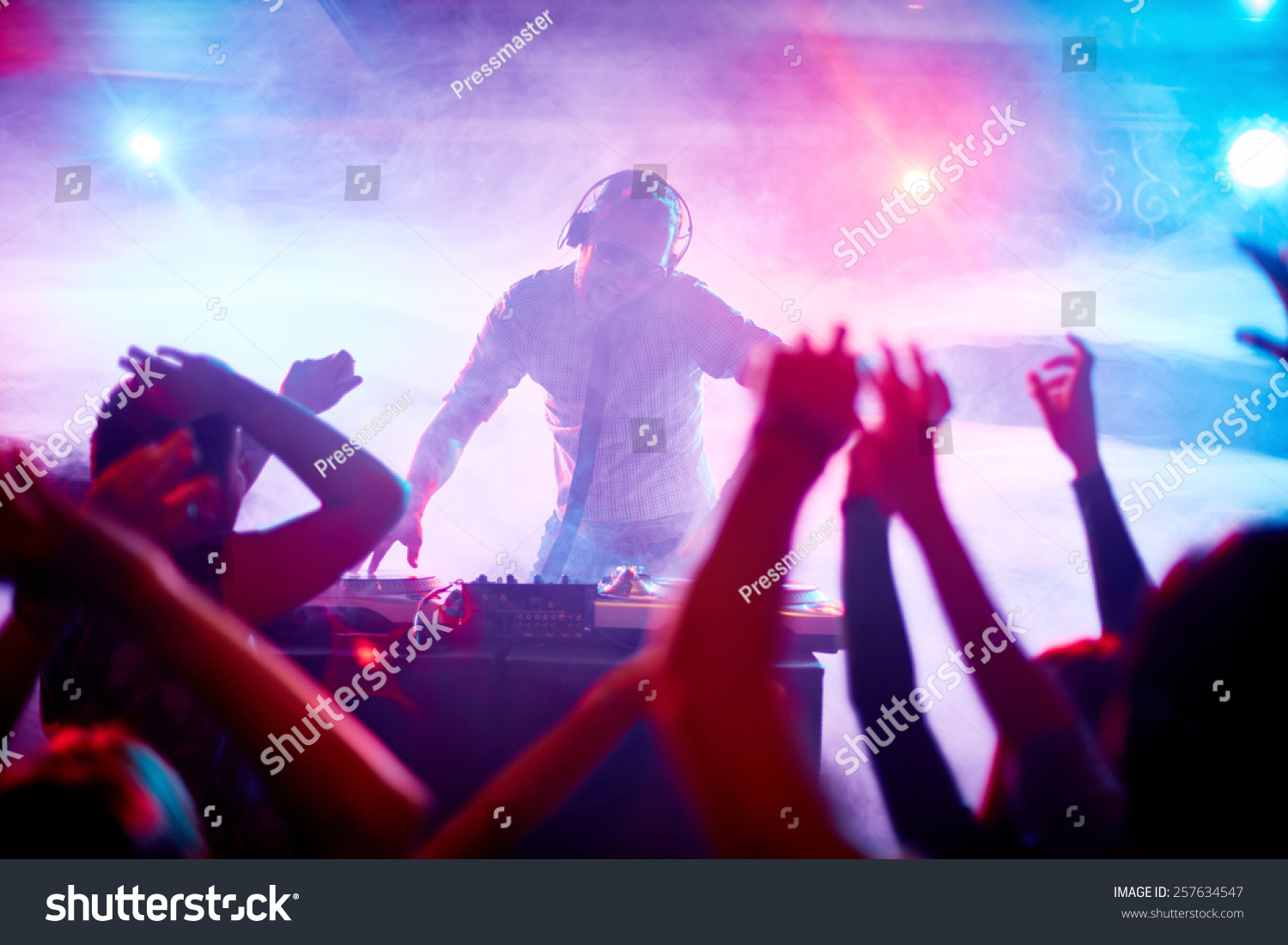 Charismatic disc jockey at the turntable #257634547