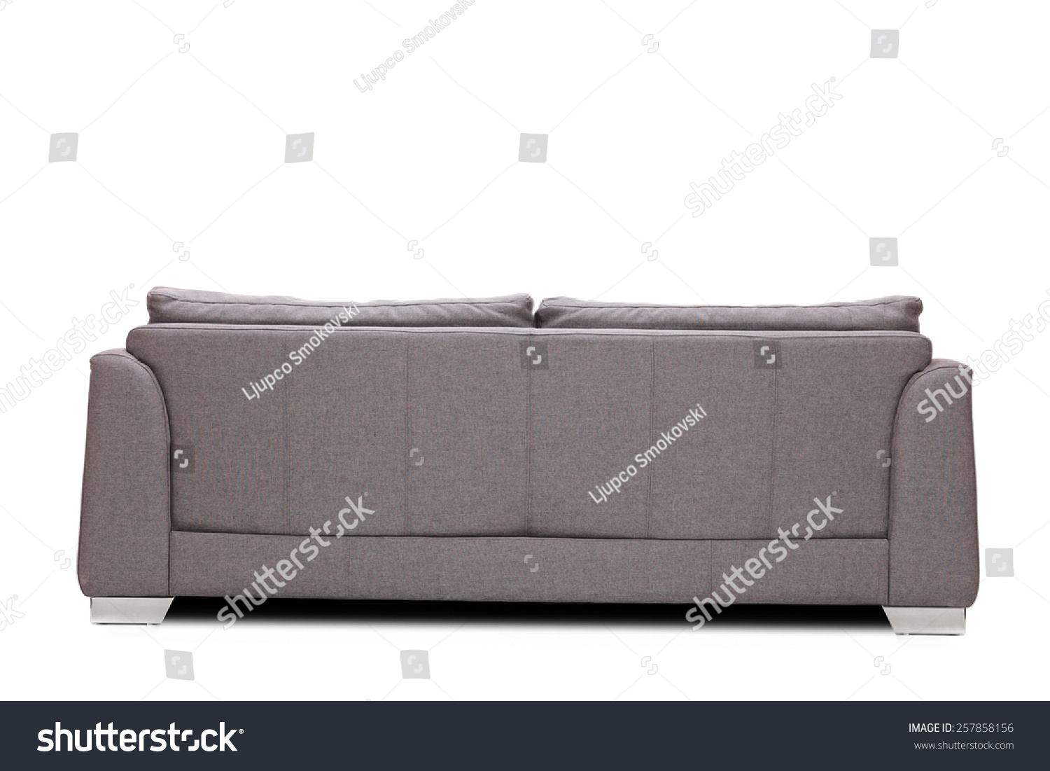Rear view studio shot of a modern gray sofa isolated on white background