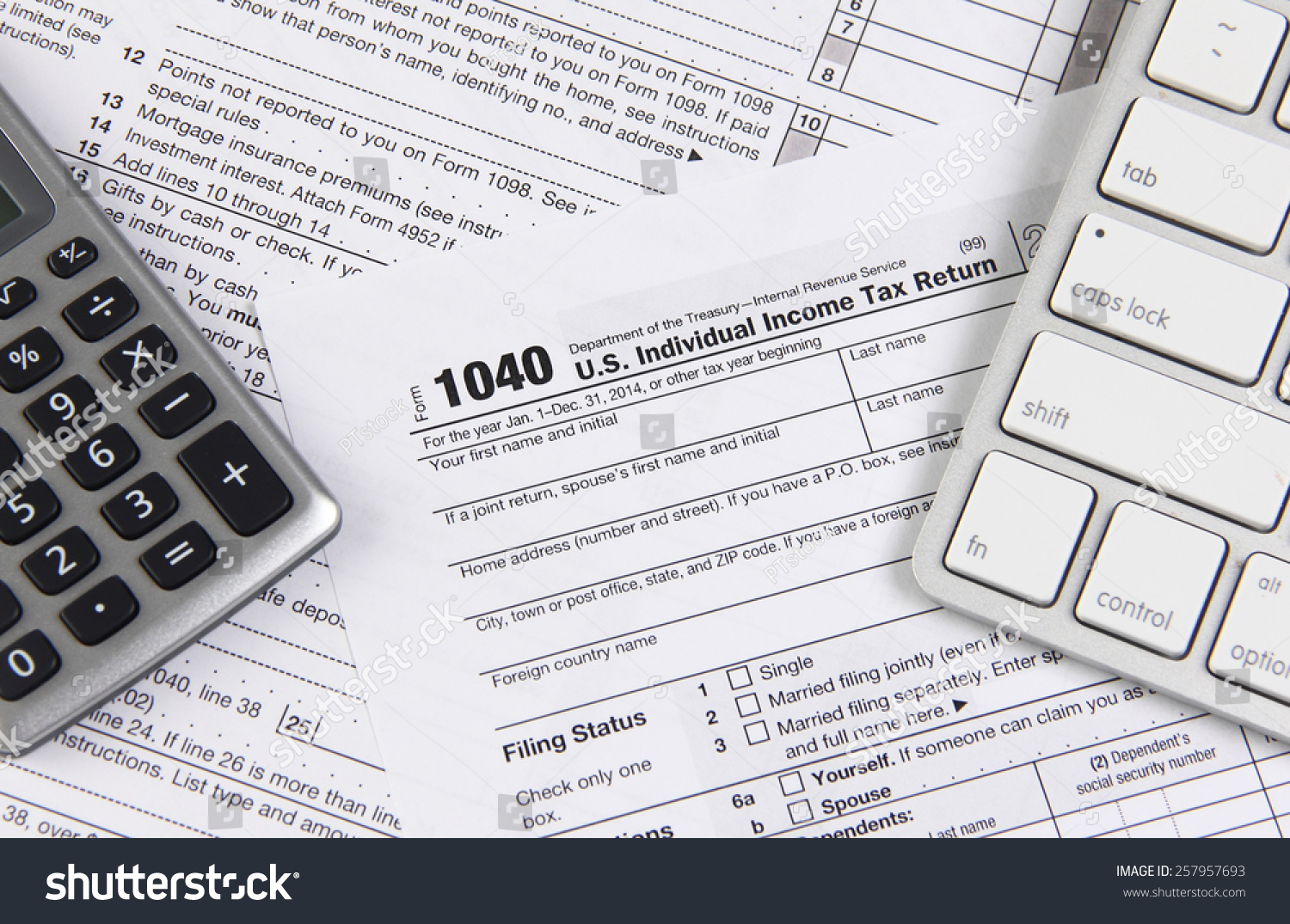Online tax filing federal 1040 form stock photo 257957693 online tax filing federal 1040 form with computer keyboard and calculator falaconquin