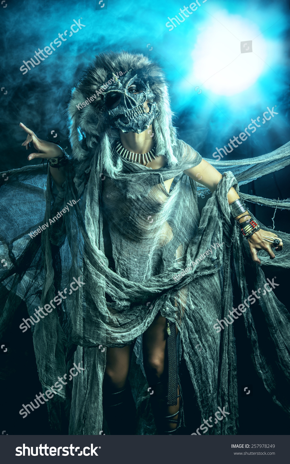 frightening female wearing mask of skull fantasy halloween witchcraft voodoo dances