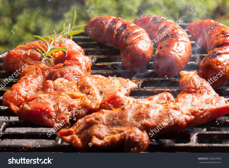 grilling sausages on barbecue grill selective focus. Black Bedroom Furniture Sets. Home Design Ideas