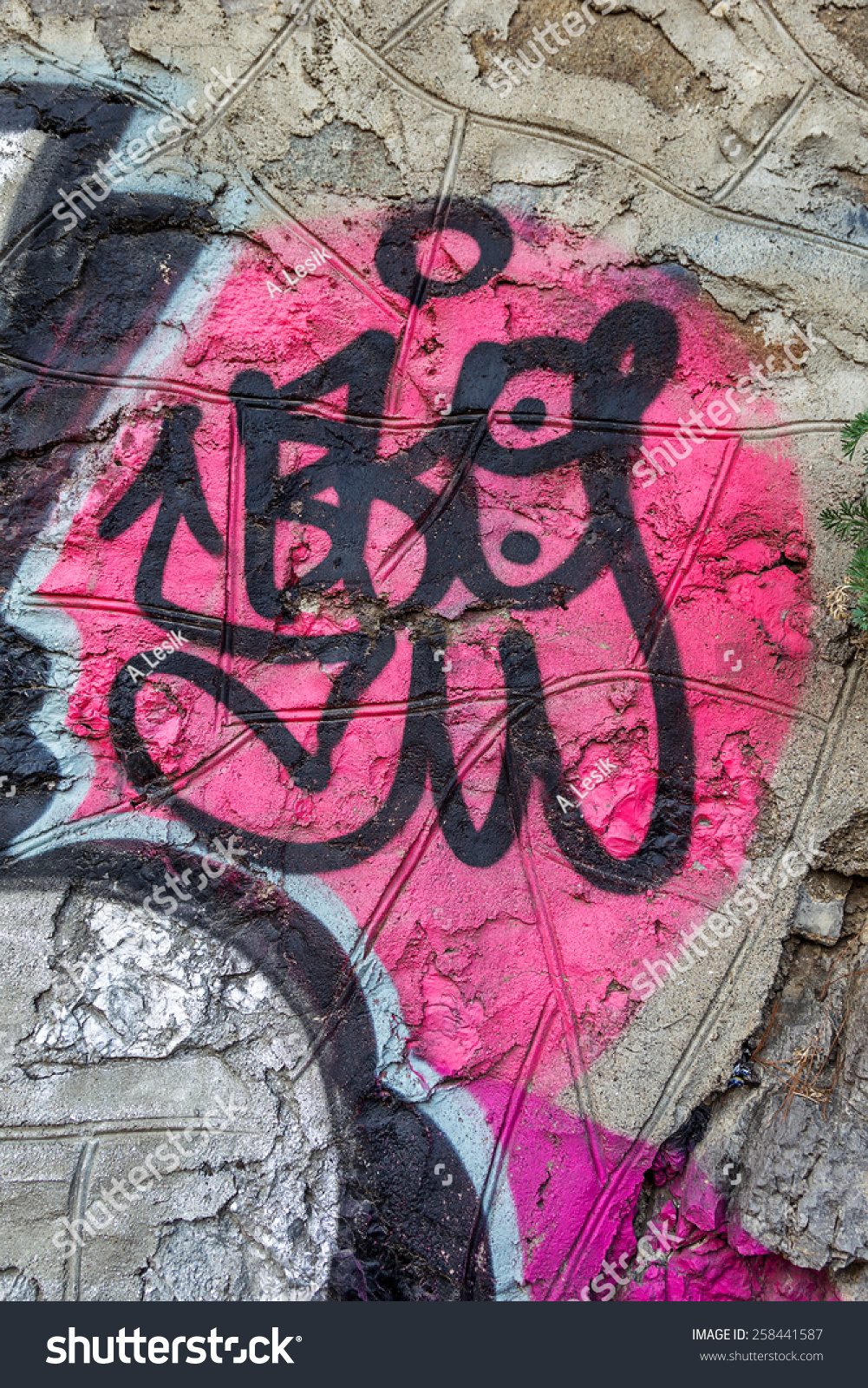 Surface of street wall with spots of abstract graffiti drawings in ...