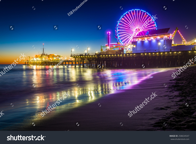 The Santa Monica Pier at night, in Santa Monica, California. #258634547