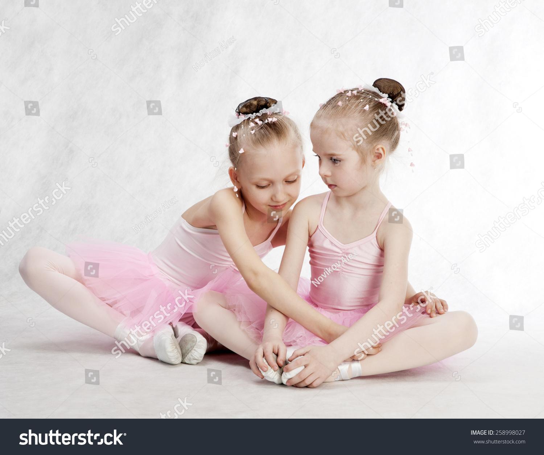 two little ballet girls sitting in tutu stock photo