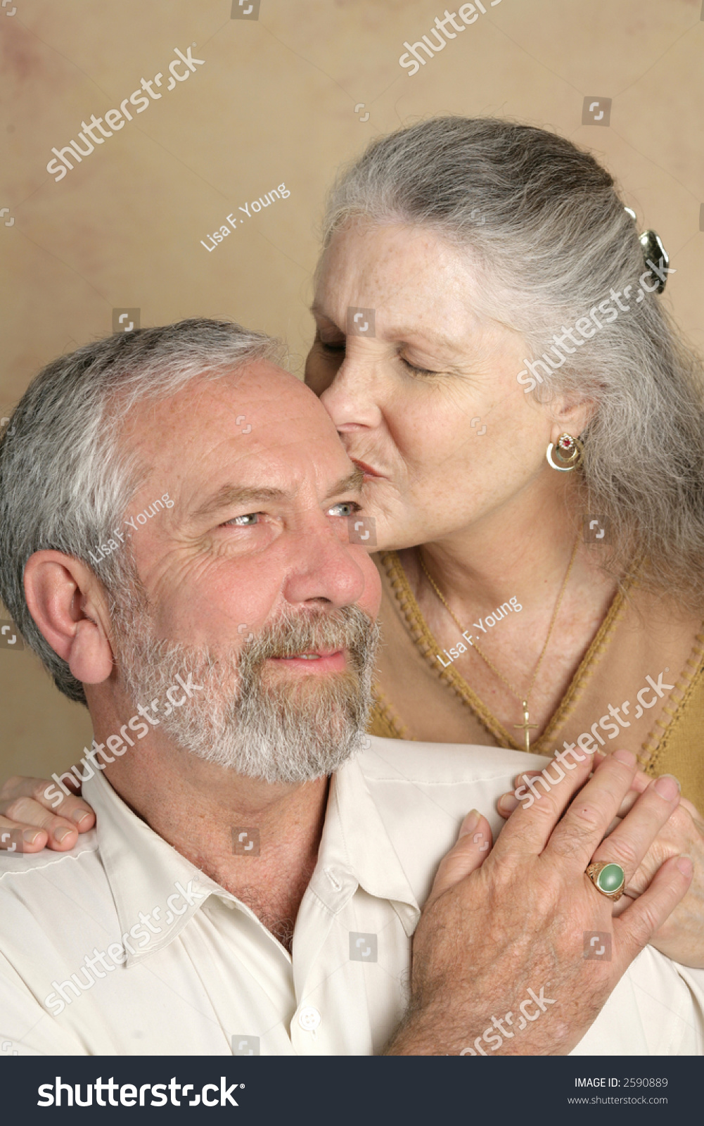 handsome mature man getting kiss his stock photo (royalty free