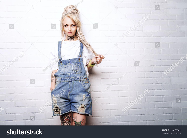 Modern teenage girl blonde dreadlocks standing stock photo for Modern teenage girl