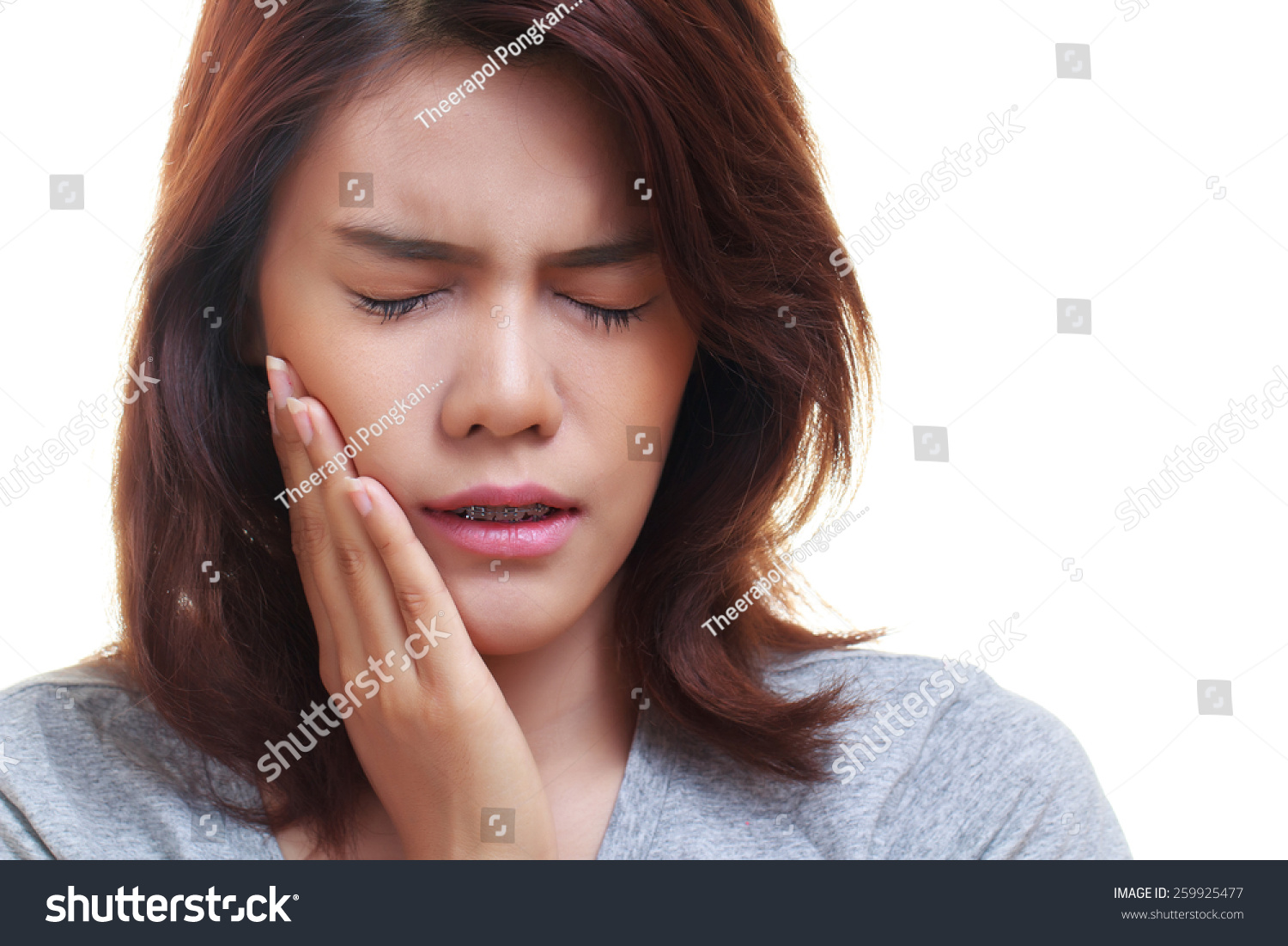 Teen Woman Pressing Her Bruised Cheek With A Painful Expression As If Shes Having A Terrible