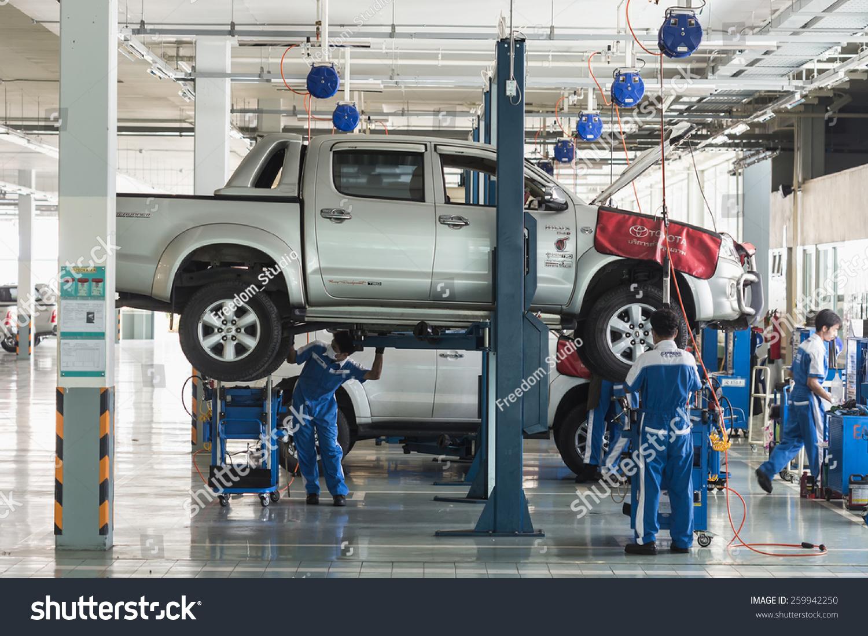 Design car repair workshop - Phuket Thailand March 10 Car Technician Repairing Car In Workshop Service Station In