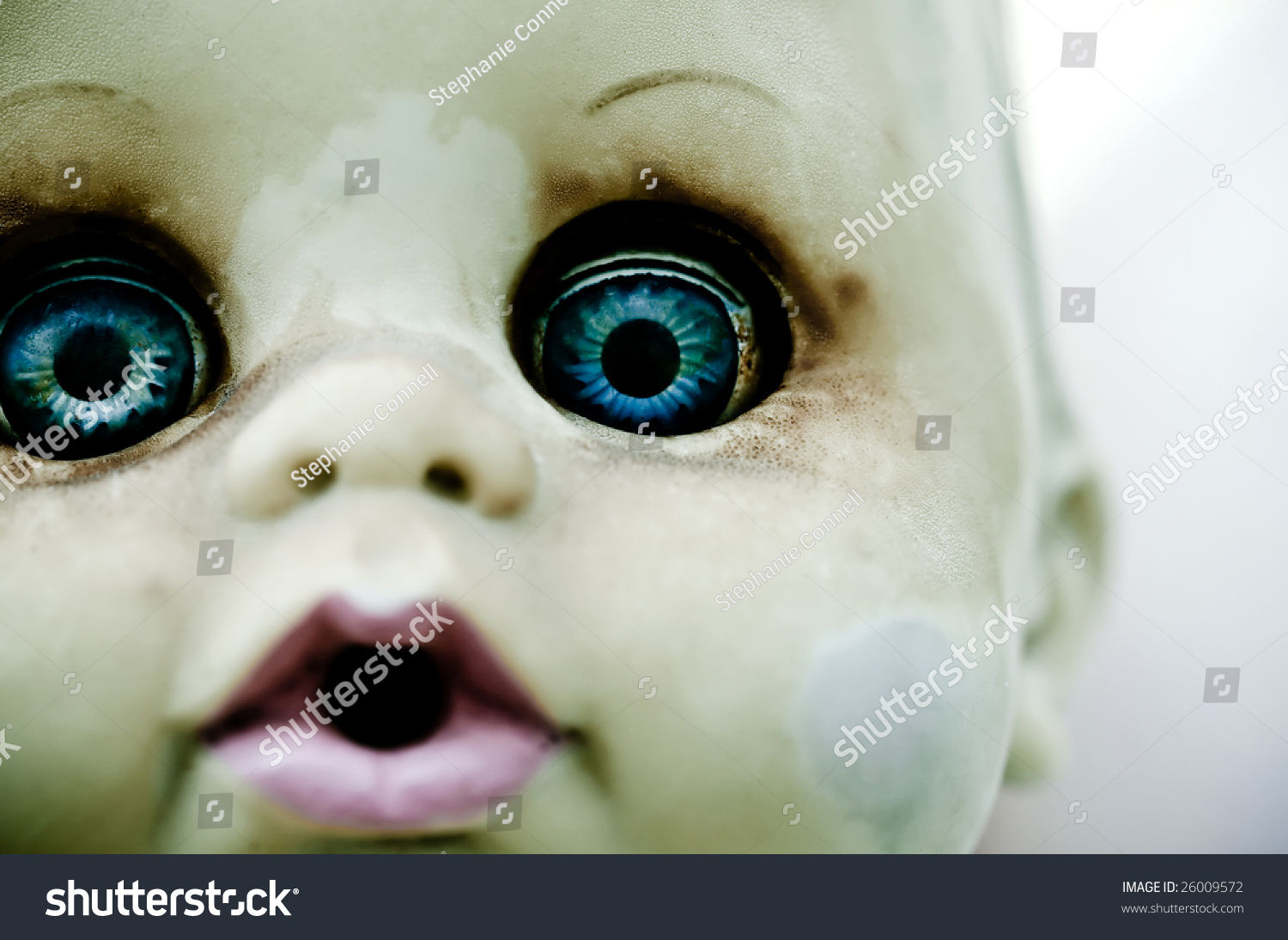 A Close Up Of An Old Doll With Bright Blue Eyes Stock ... Bright Blue Eyes Close Up Tumblr