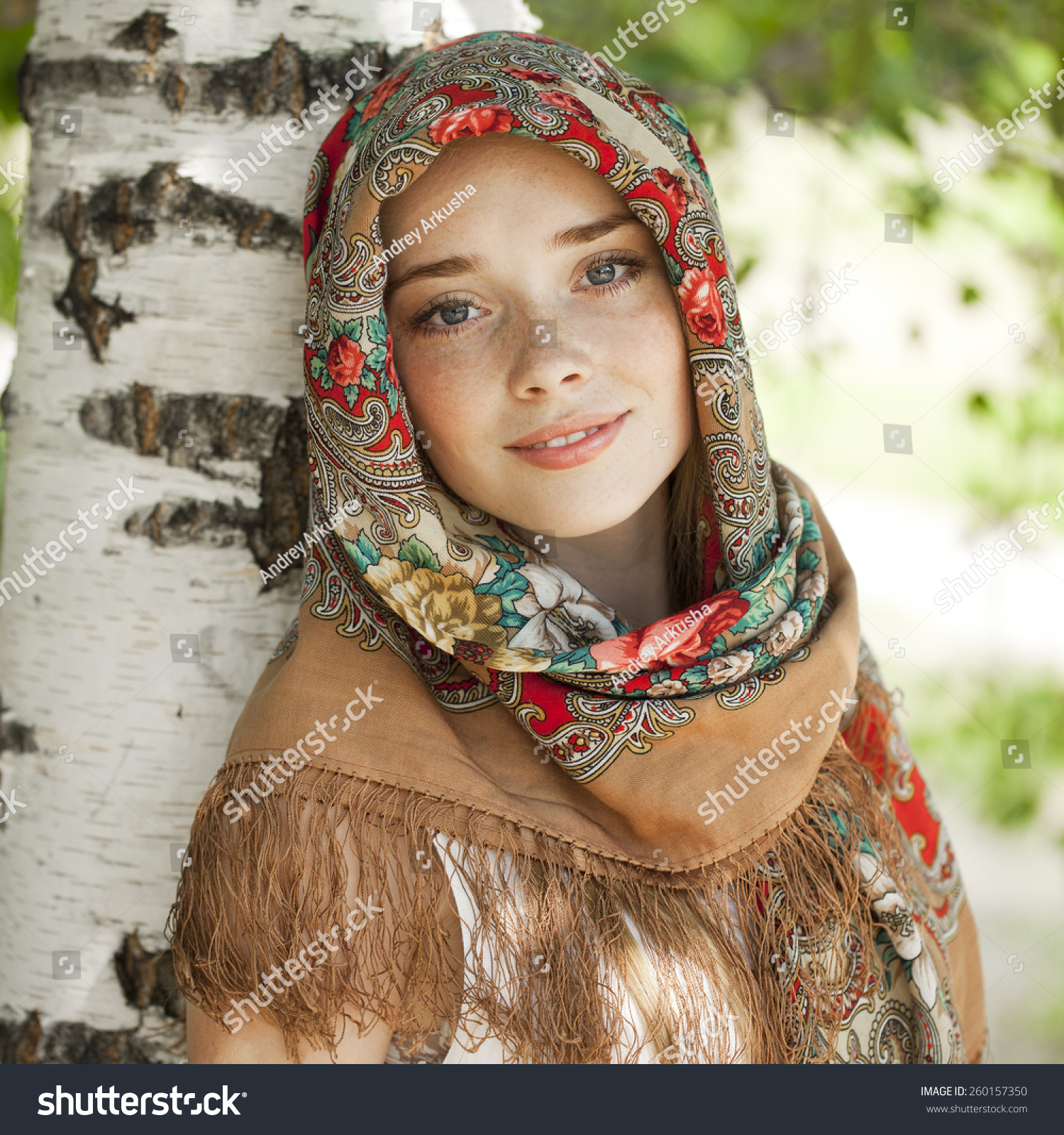 https://image.shutterstock.com/z/stock-photo-russian-beauty-woman-in-the-national-patterned-scarf-260157350.jpg