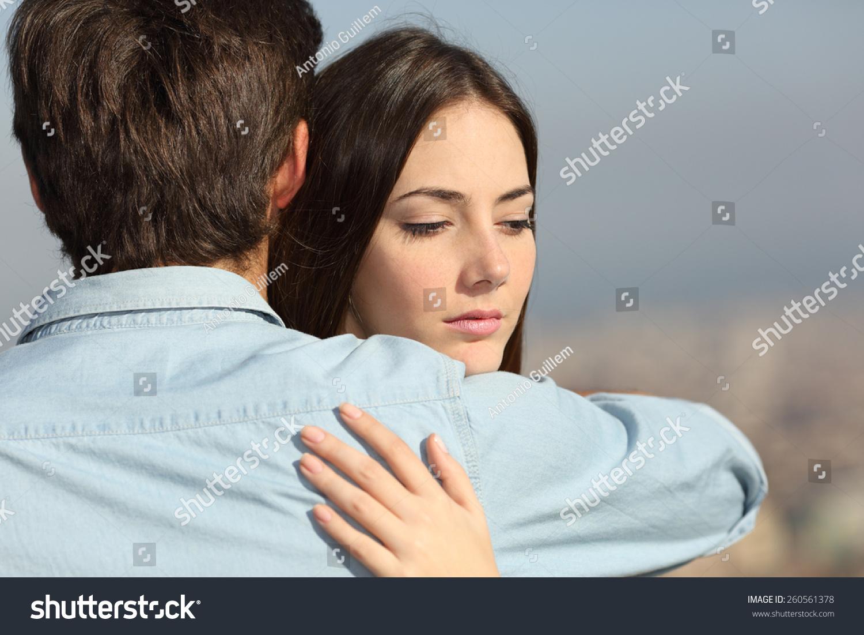 Sad Woman Hugging Her Boyfriend Looking Stock Photo ...