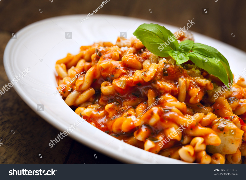 pasta with homemade tomato and zucchini sauce garnished with fresh ...