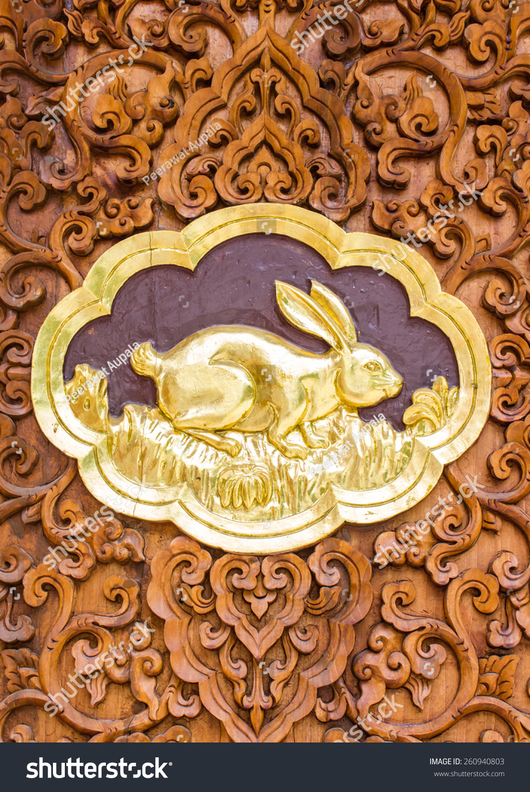 Rabbit wood carving wall sculptures thai stock photo