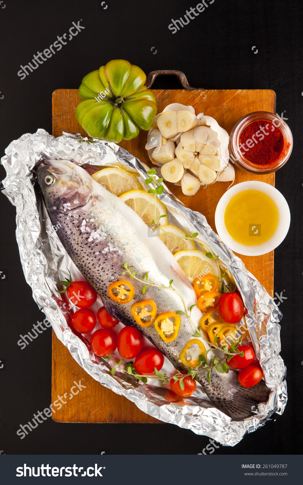 Raw fish vegetables on wooden board stock photo 261049787 for Fish with vegetables