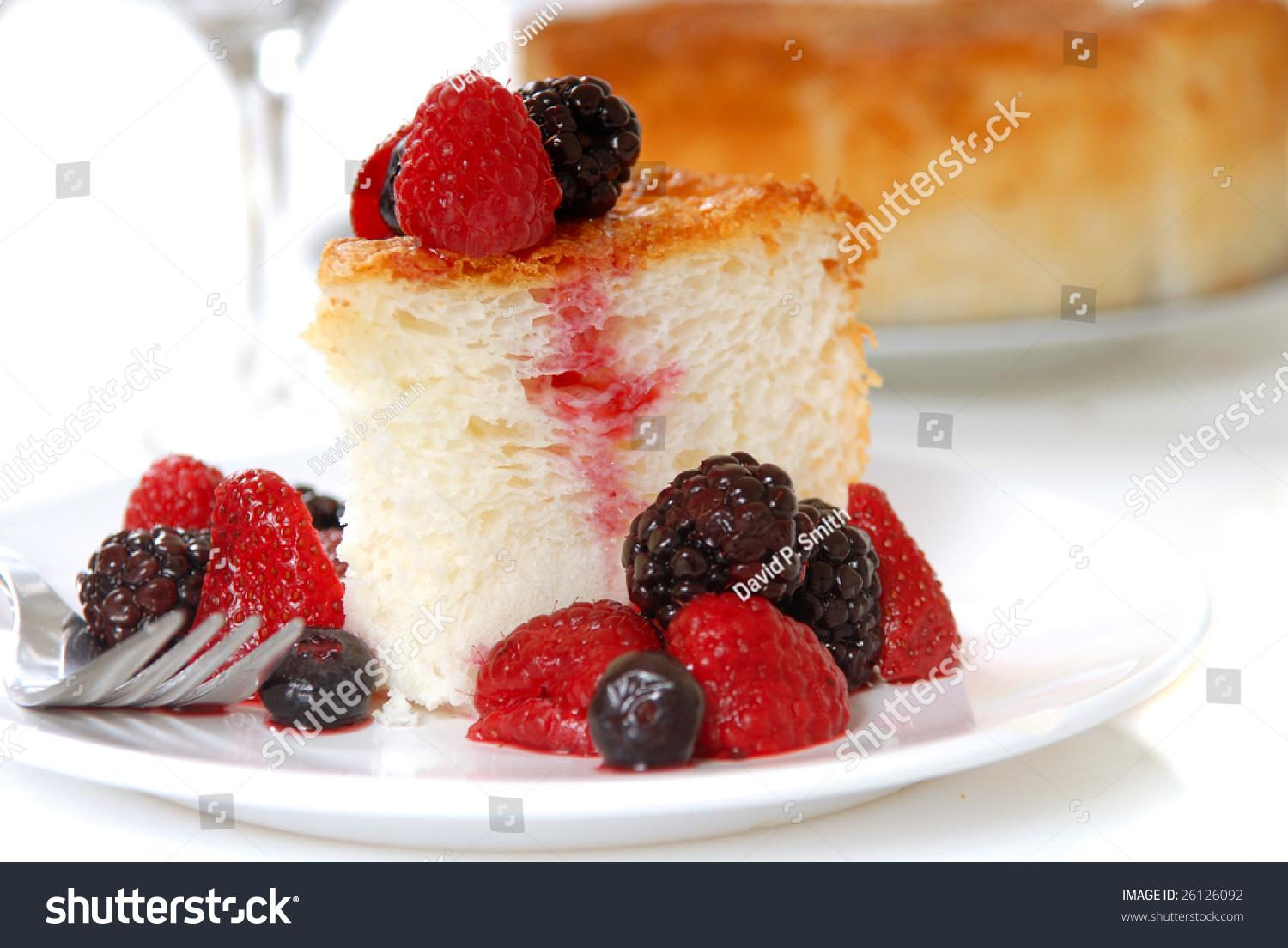 Slice Of Freshly Baked Angel Food Cake With Fresh Fruit Stock Photo ...