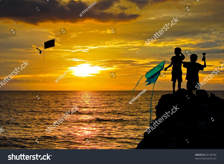 Children Flying Kite At Sunset Stock Photo 26128183 ...