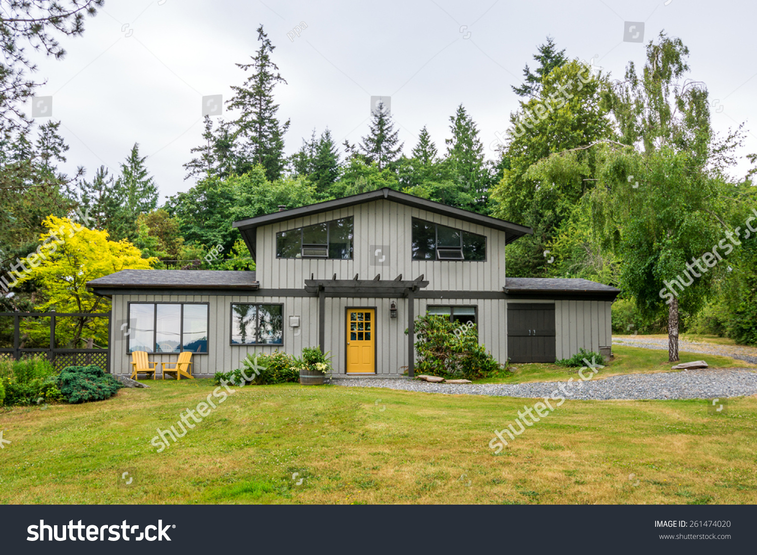 Midcentury modern cottage house woods exterior stock photo for Modern house in the woods